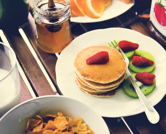 Closeup of pancake top with strawberry breakfast
