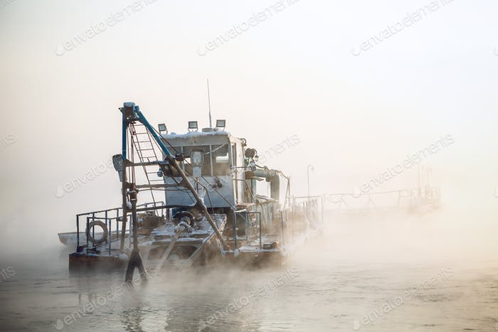 dredge boat in the fog