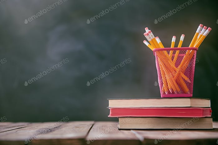 Pencils and pile of books