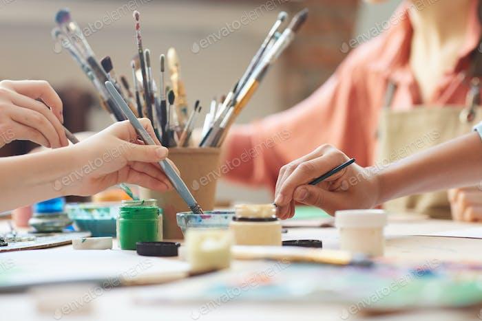 Children using watercolor paints