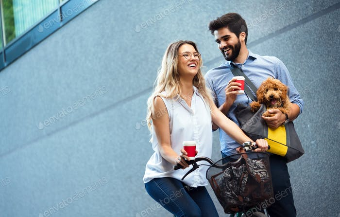Couple in love with dog walking and smiling outdoor