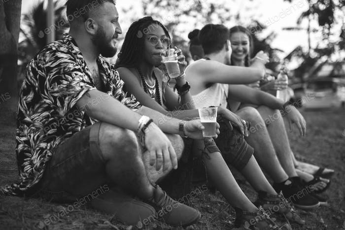 Group of Friends and Beers Enjoying Music Festival Together
