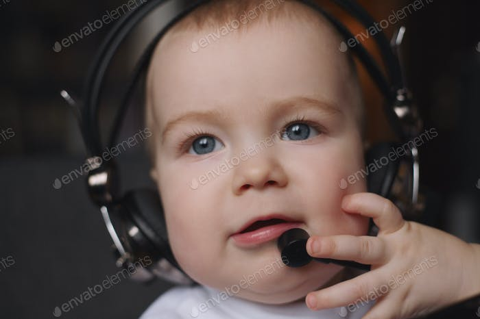 little boy using headphones with mic