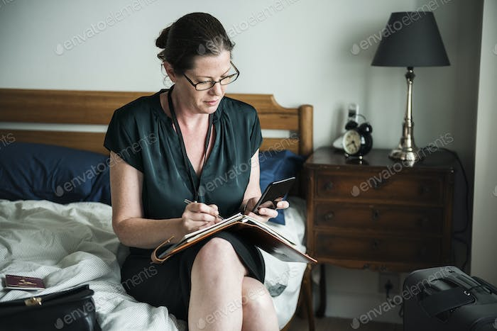 A woman working in bed