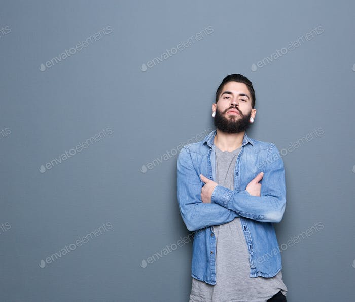 Young guy posing on gray background