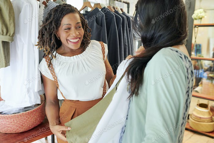 Happy youg woman shopping with friend