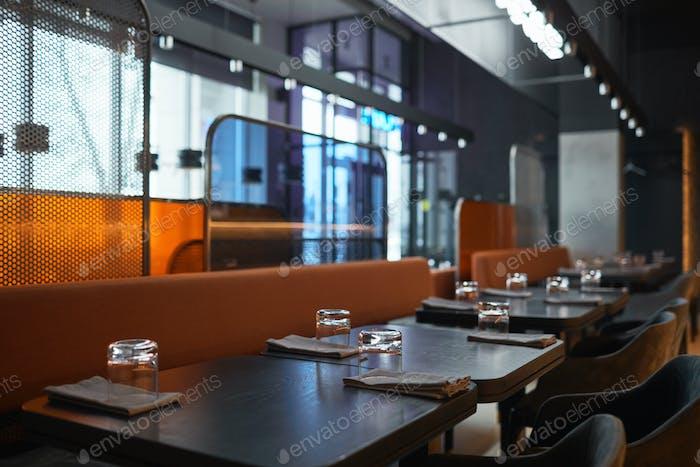 Different-textured panels between seats in bistro cafe