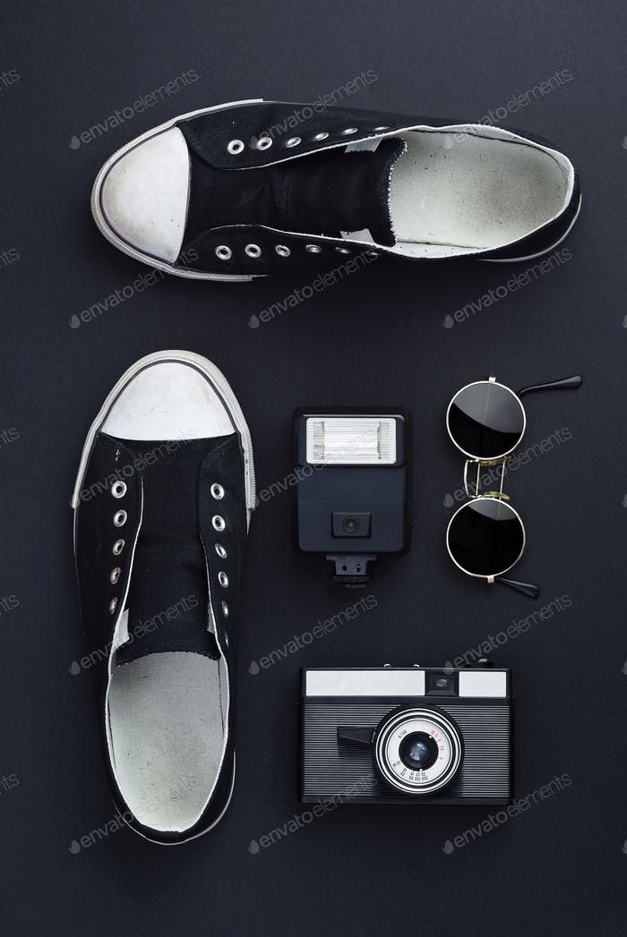 Sneakers, photo camera, flash and round sunglasses
