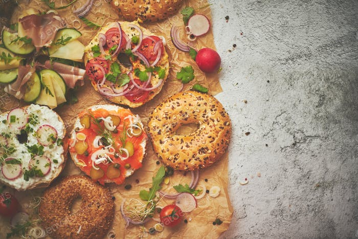 Composition of various homemade bagels sandwiches with sesame and poppy seeds