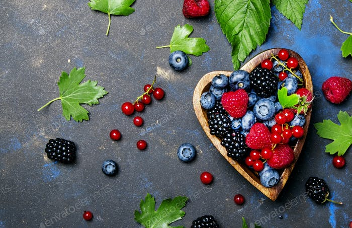 Mix of summer berries in heart shape bowl