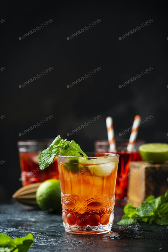 Red fresh cocktail with ice and lime