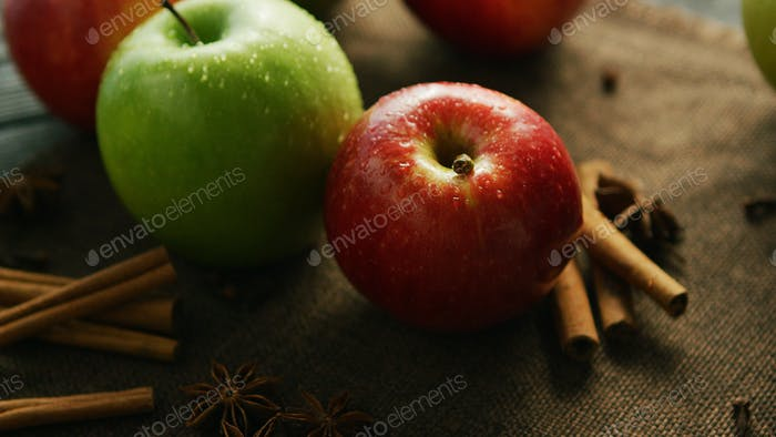 Apples and spices on table