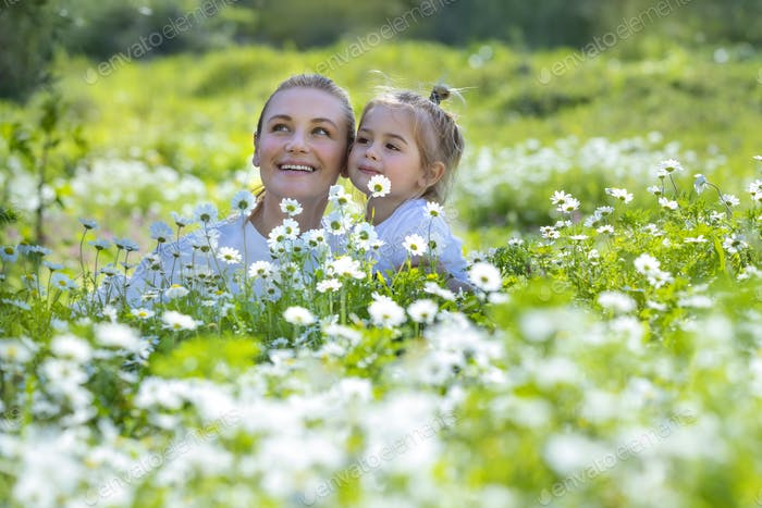 Mother and Son on Flowers Field
