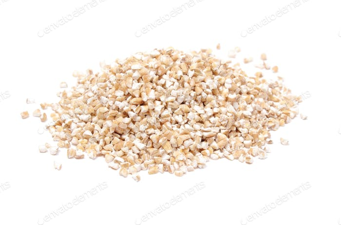 Heap of barley groats isolated on white background