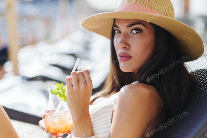Seductive woman drinking cocktail