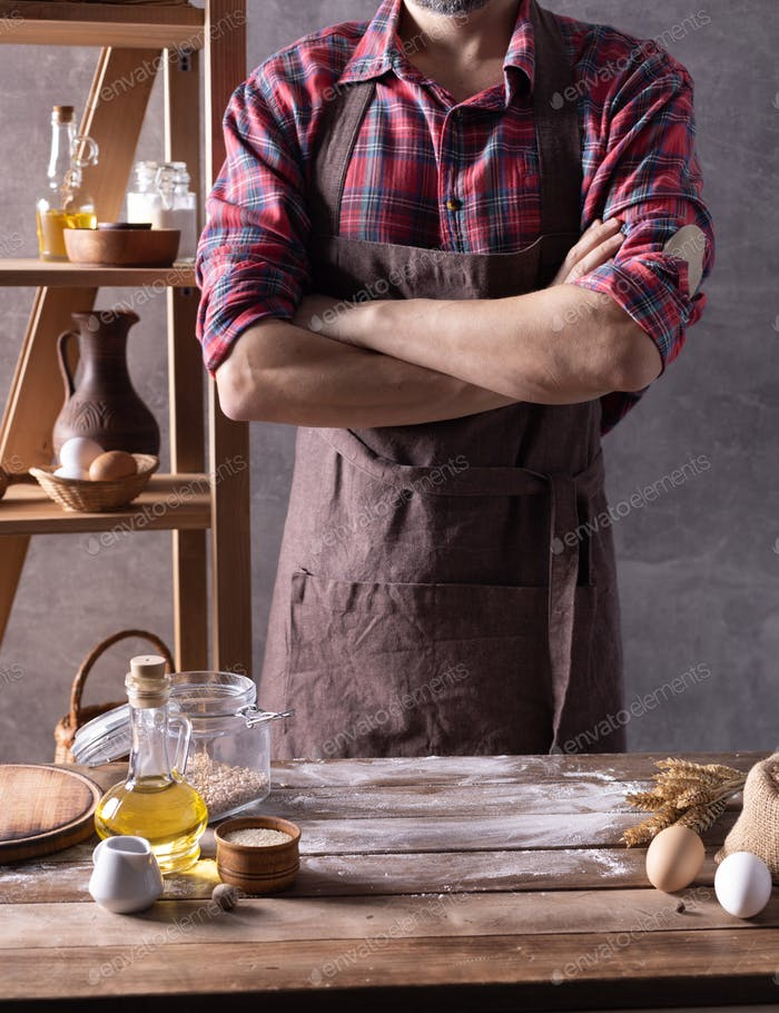 Baker man and bread or bakery ingredients for homemade bread cooking on table