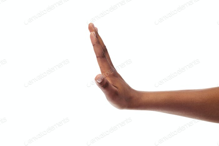 Black female hand showing stop gesture, isolated on white background