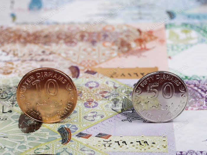 Qatari coins on the background of money