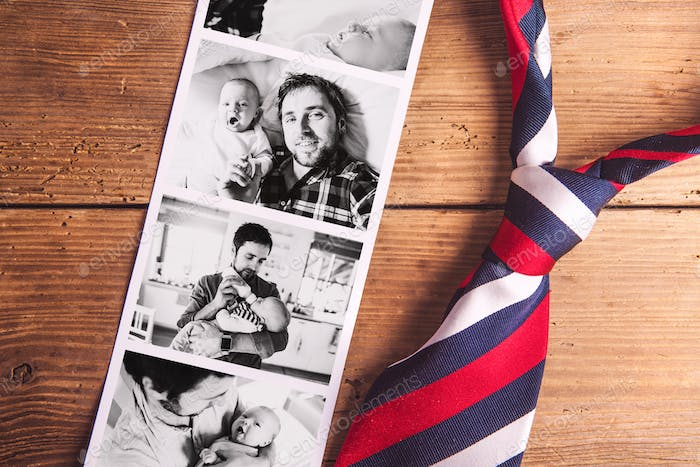 Pictures of father and baby son. Fathers day. Studio shot.