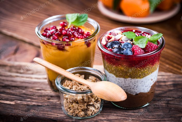 Colorful and healthy natural desserts in jar with chia