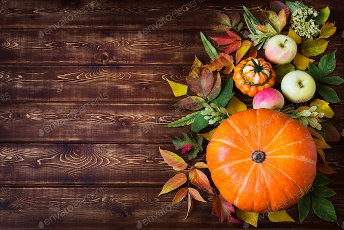 Rustic fall decor with pumpkin, apples, copy space
