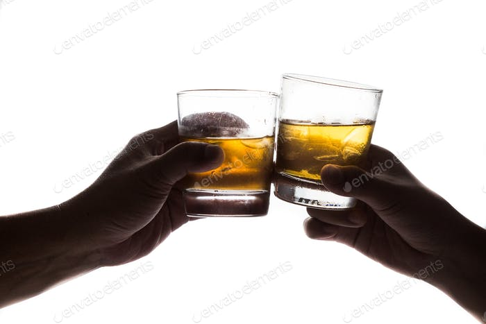 Silhouette of two hands toasting whiskey on the rock, in white background
