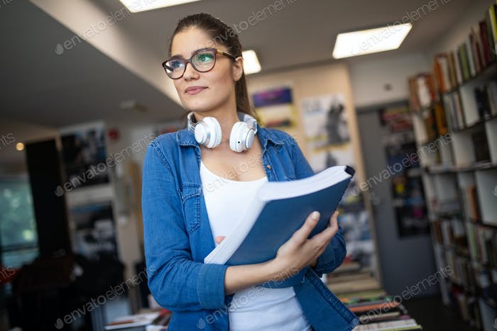 Beautiful student woman studying and learning at college