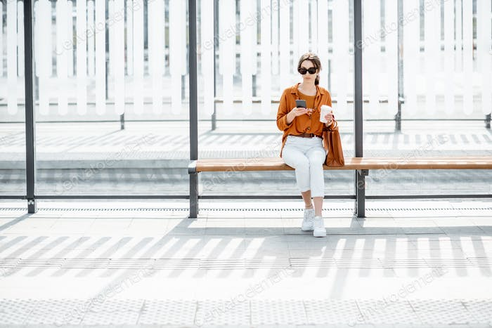 Woman at the public transport stop