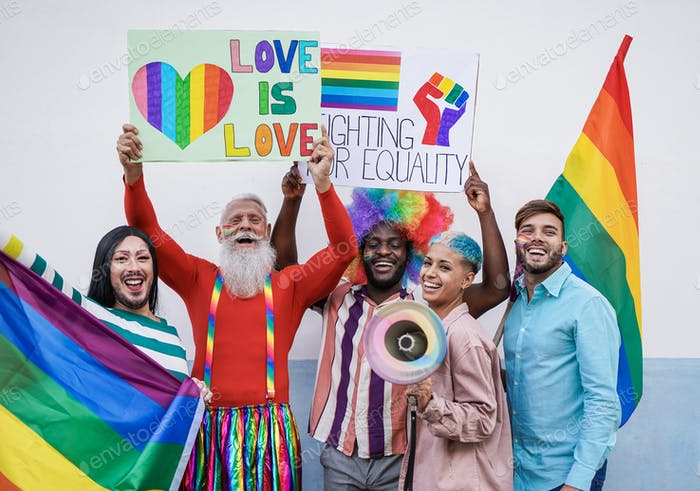 Happy multiracial people laughing with banner at gay pride parade - Homosexual love
