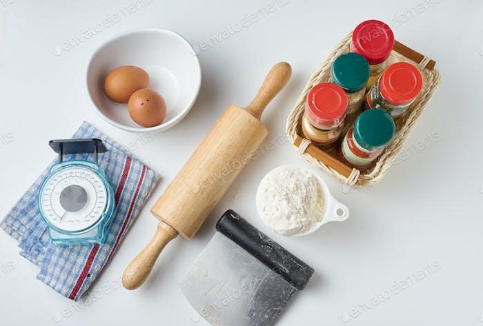 Group of kitchen utensil on white floor