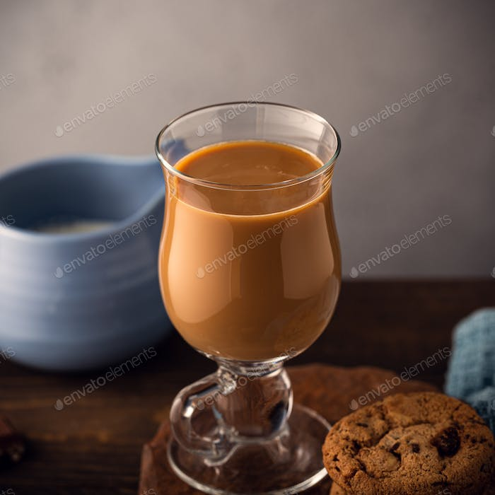 Coffee break composition with glass