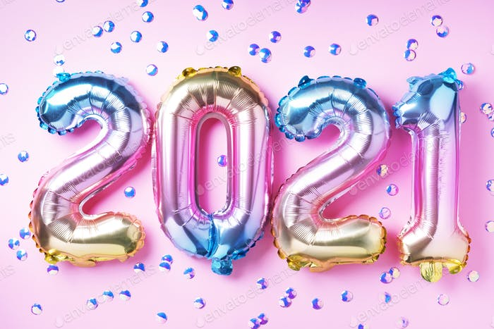 Colorful foil balloons made numbers 2021 on pink background with light bokehs. Happy new year