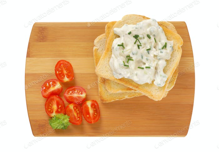 toasted white bread and creamy chives spread