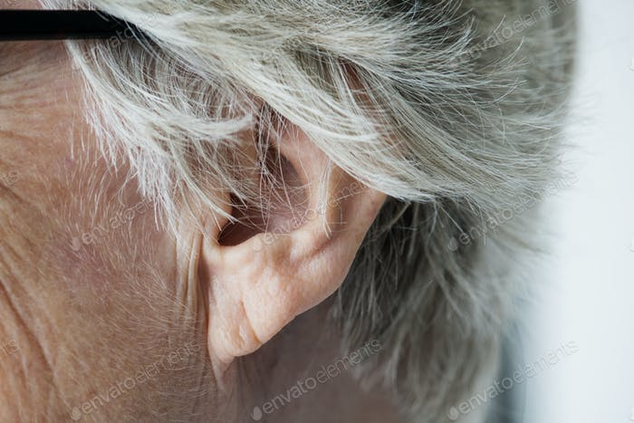 Closeup of elderly woman's ear