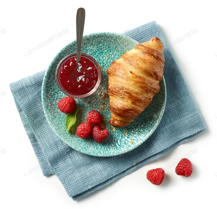 freshly baked croissant on blue plate