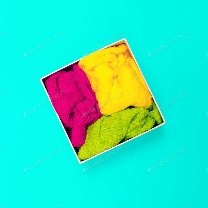 Multicolored napkins in a box. Minimal art