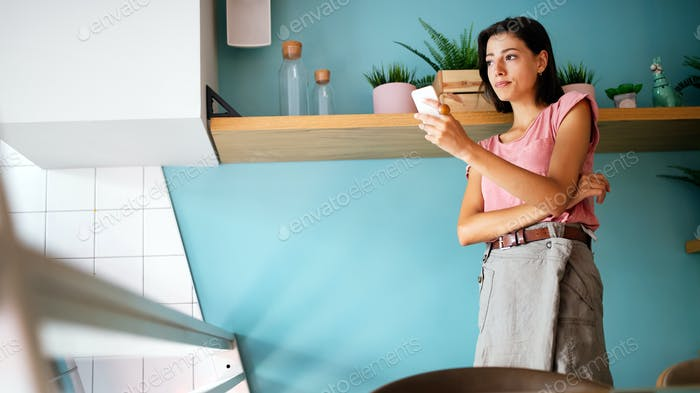 Image of young woman using cellular phone