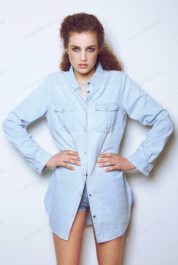 Fashion model posing against white background