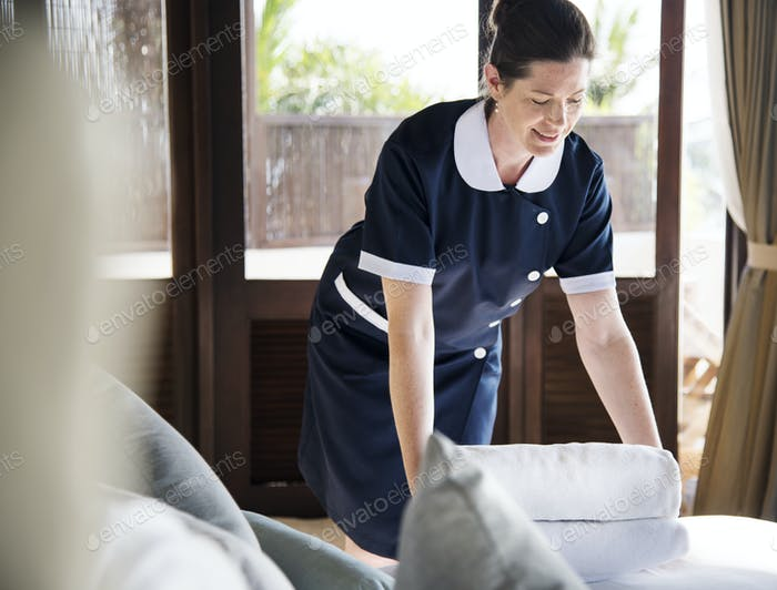 Housekeeper cleaning a hotel room