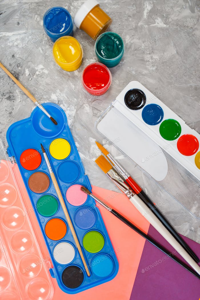 Watercolor paints on the table in stationery store