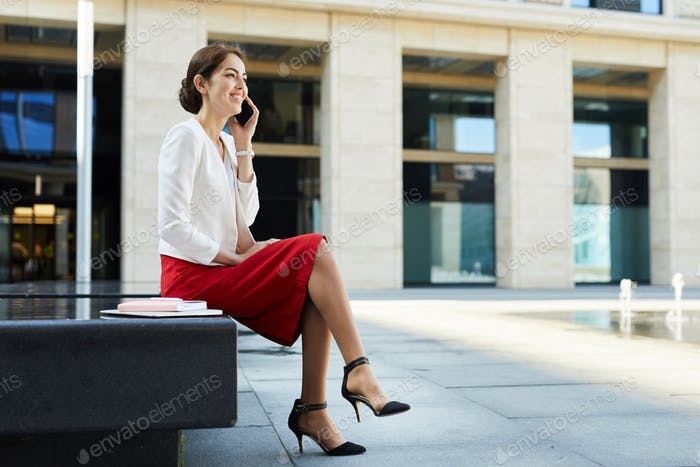 Elegant Businesswoman Speaking by Phone