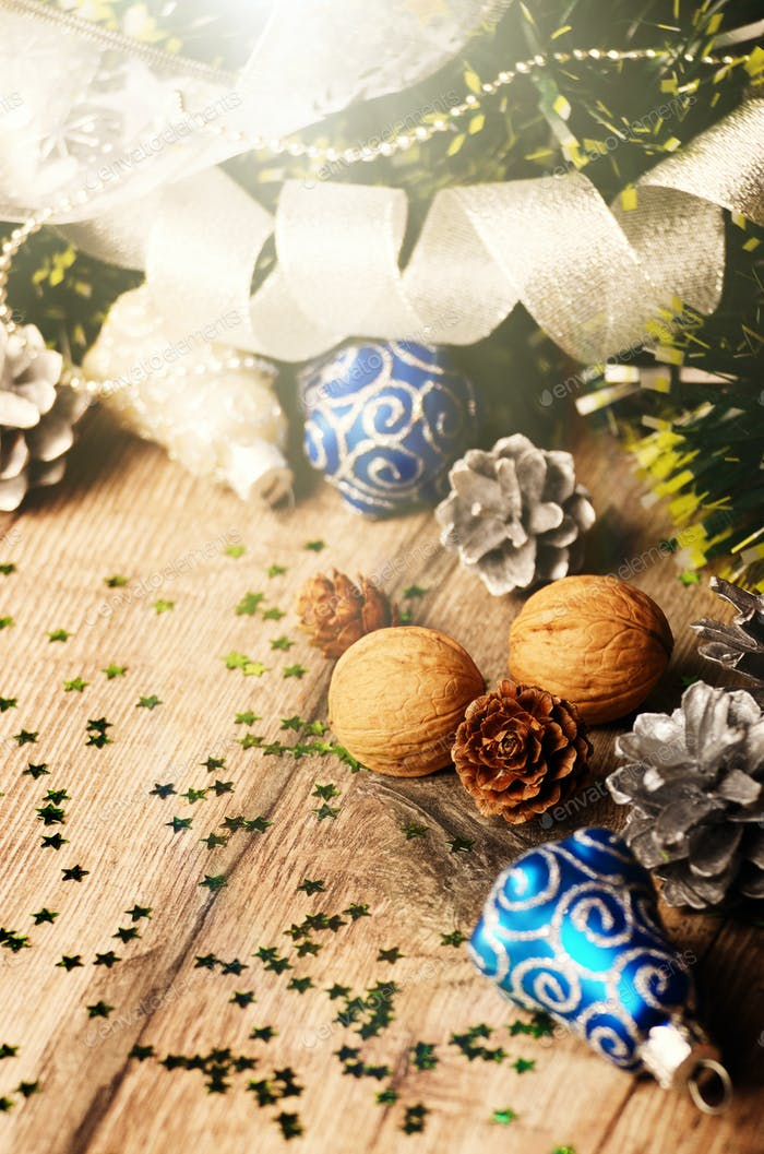Christmas background of nuts stripes and decorations