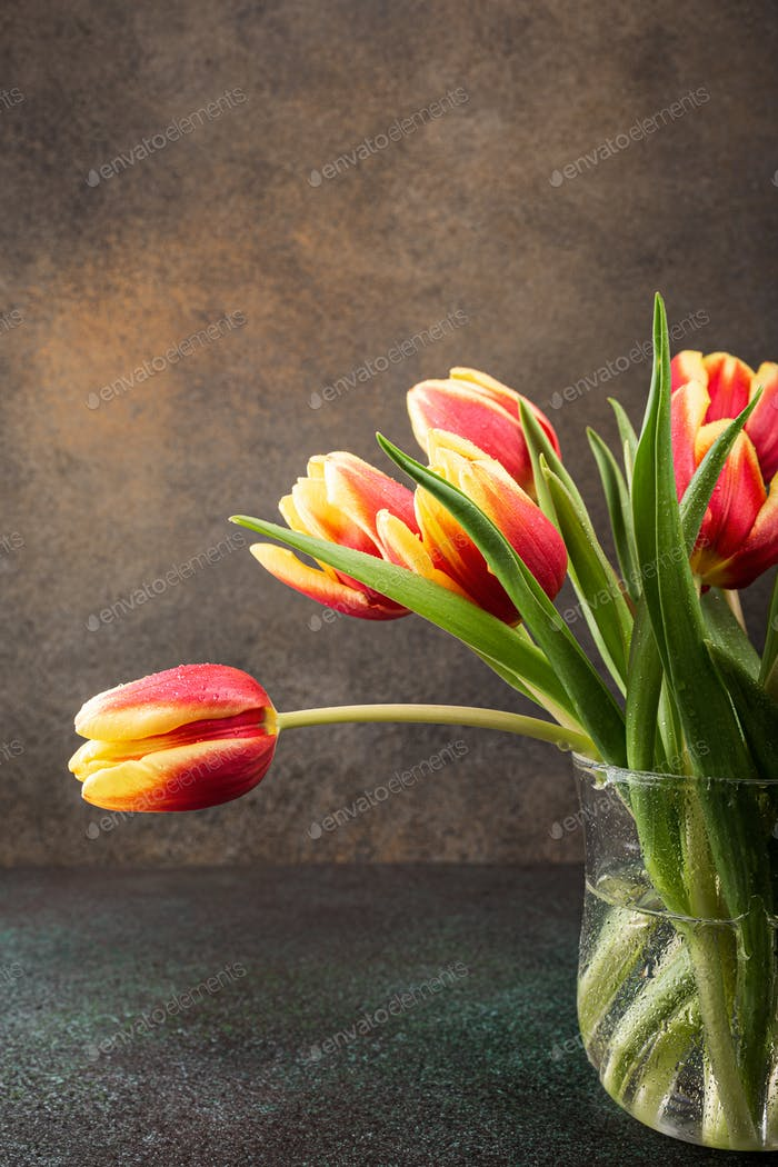 Red yellow tulips in glass vases