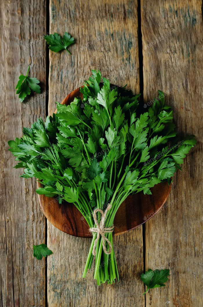 Fresh Parsley Bunch on a wood background