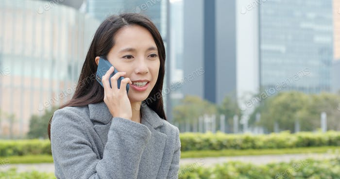 Businesswoman talk to mobile phone at outdoor