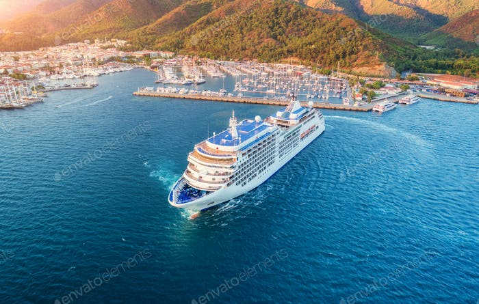 Aerial view of beautiful white cruise ship at sunset