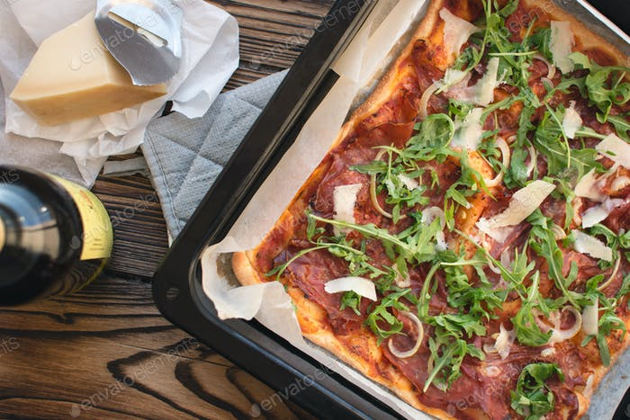 Homemade pizza prosciutto crudo and arugula