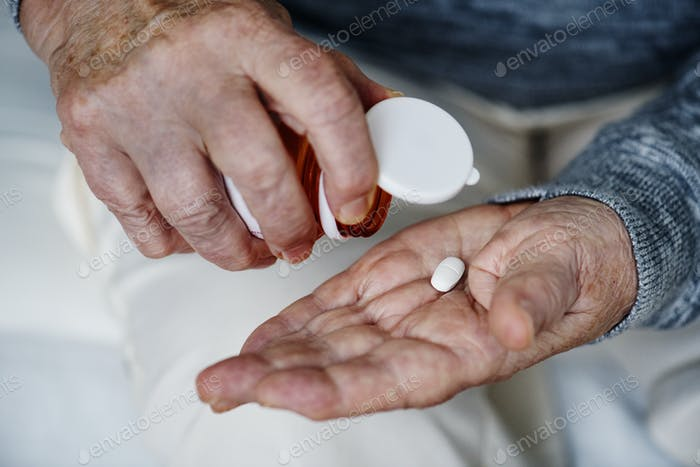 Elderly woman taking a medicine