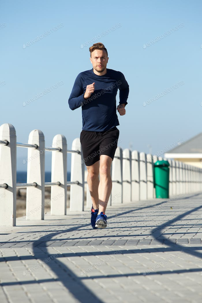 active young man running outside