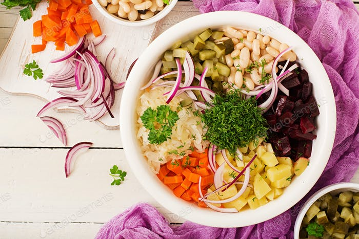 Beet salad Vinaigrette in a white bowl. Flat lay. Top view